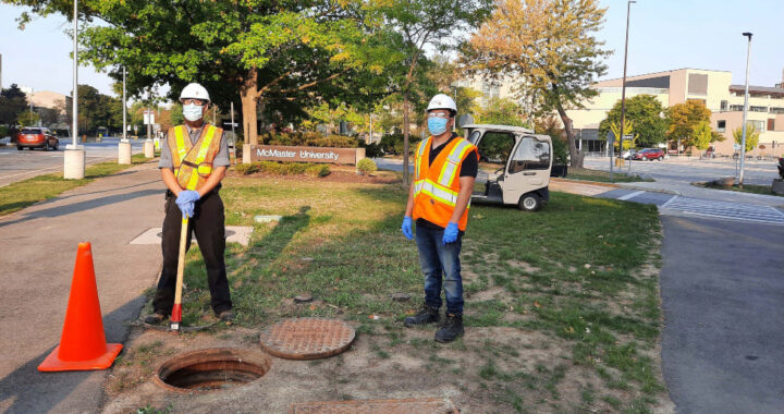 McMaster Facilities Operators take a Waste Water sample on campus